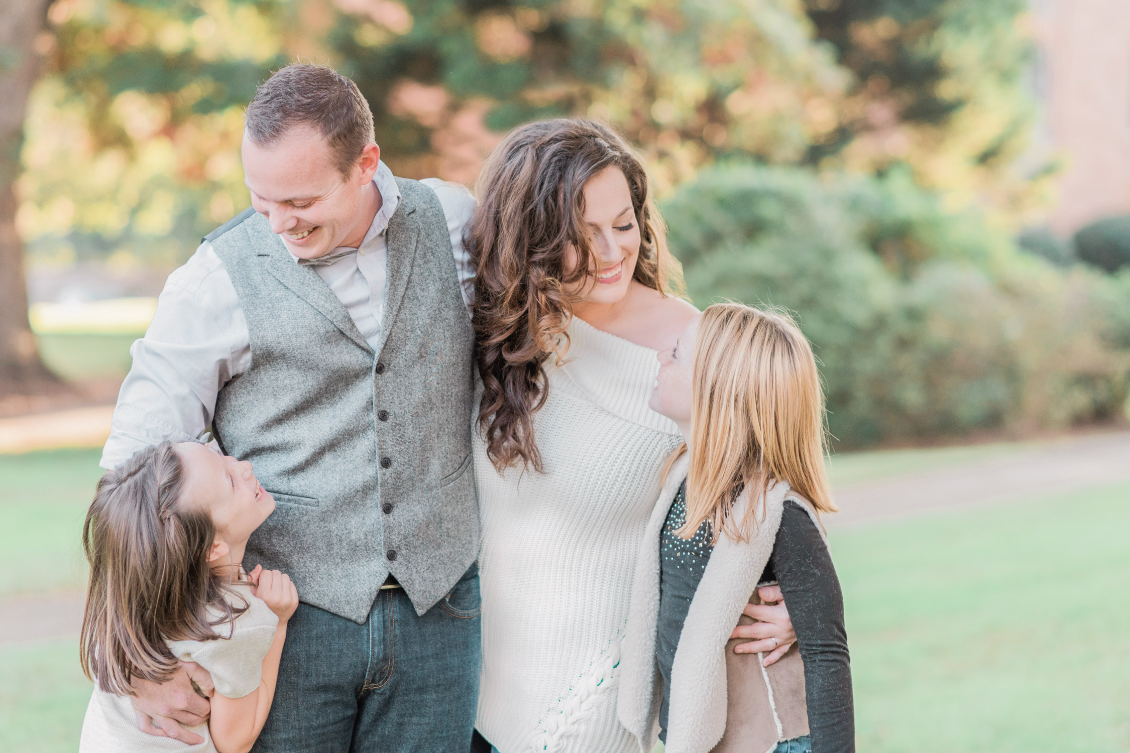 Melissa Brewer fine art film wedding photographer with husband and two daughters in the fall long curly brown hair family