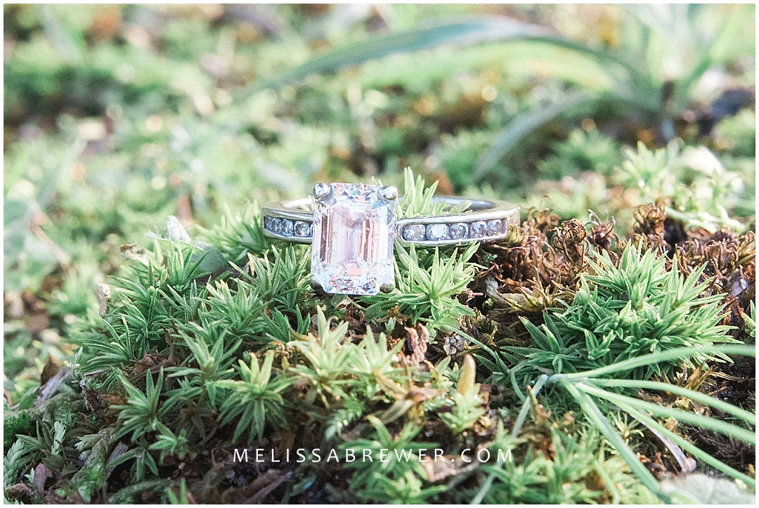 engagement ring close up macro shot on green moss