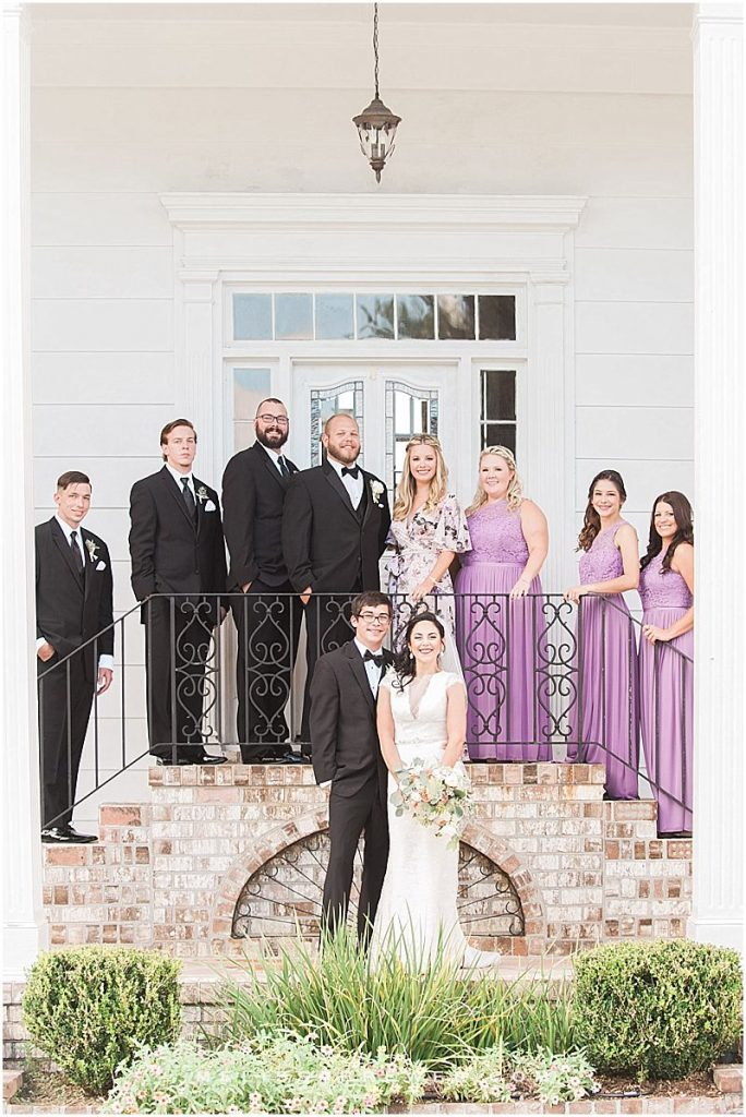 Bridal Party photos at The Island House purple lavender lilac bridesmaids flowers wedding photographer in Charleston SC