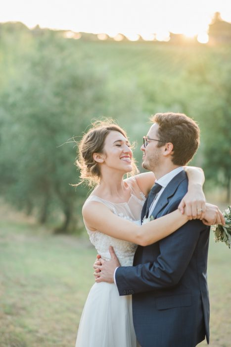 Bride and groom laughing together in olive orchards Cortona Italy wedding vineyards Tuscany Italy destination wedding photographer Melissa Brewer Photography fine art film wedding photographer in SC