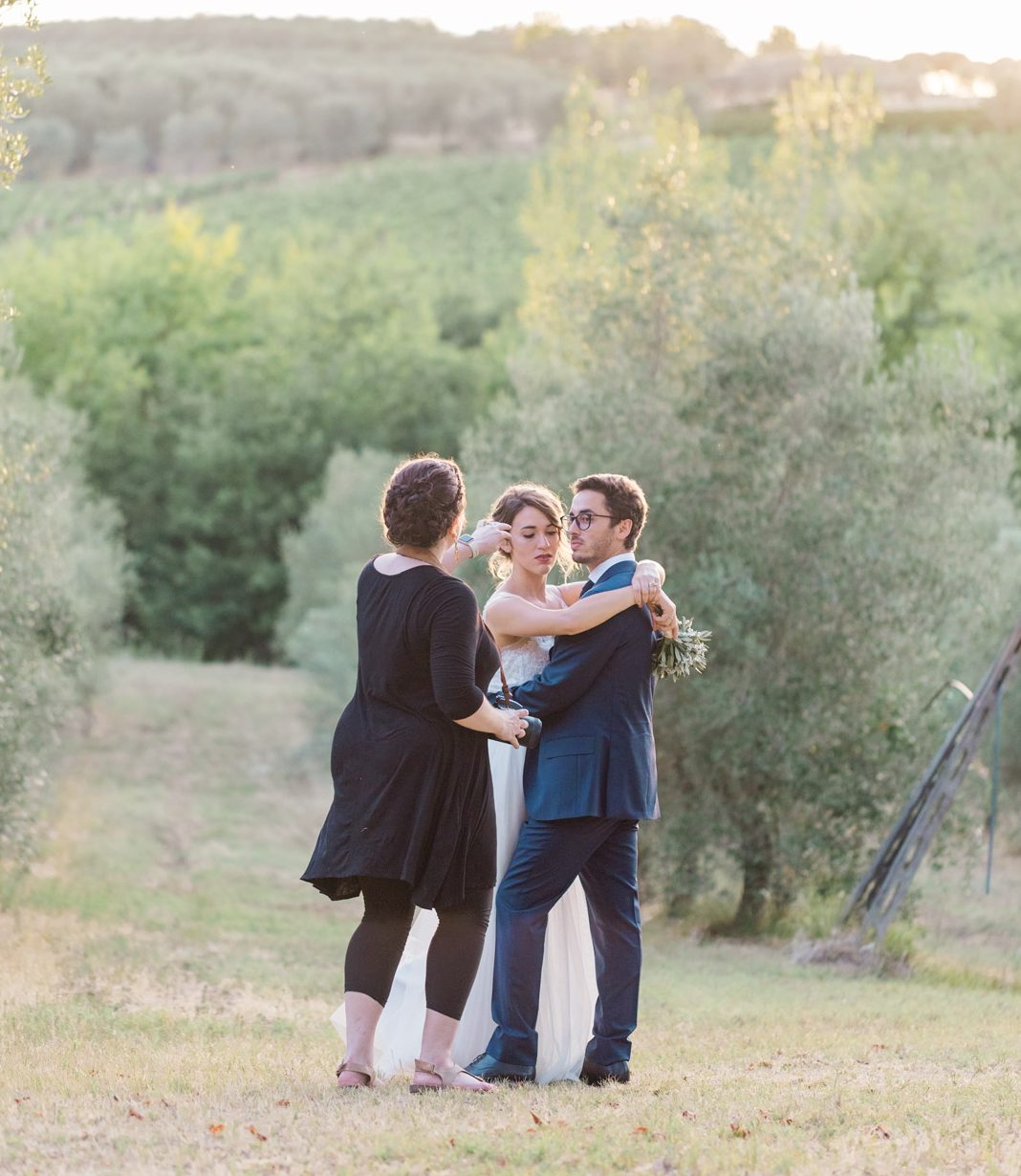 Melissa Brewer Photography working with bride and groom on posing in Tuscan olive orchard and vineyards in Cortona Italy destination wedding photographer