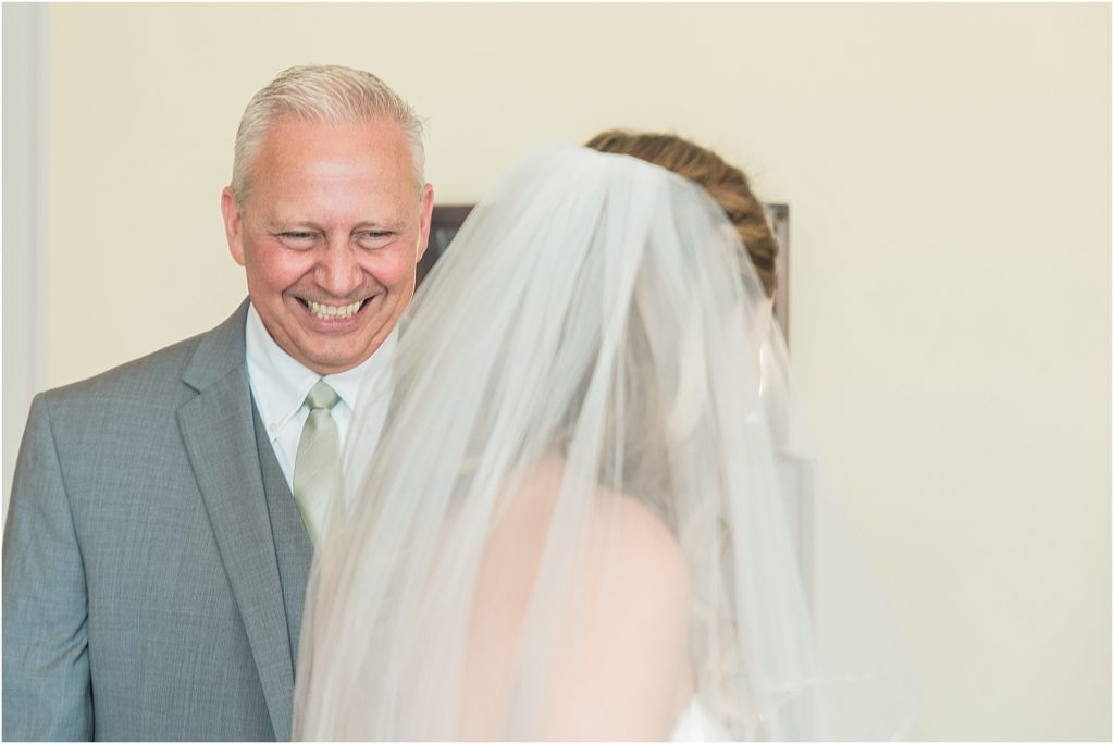 bride's father first look smiling laughing father of the bride lake murray chapin sc