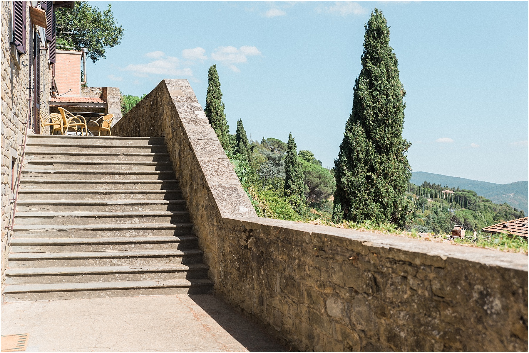 villa in cortona tuscany italy stone medieval stairs leading to wedding villa cypress trees