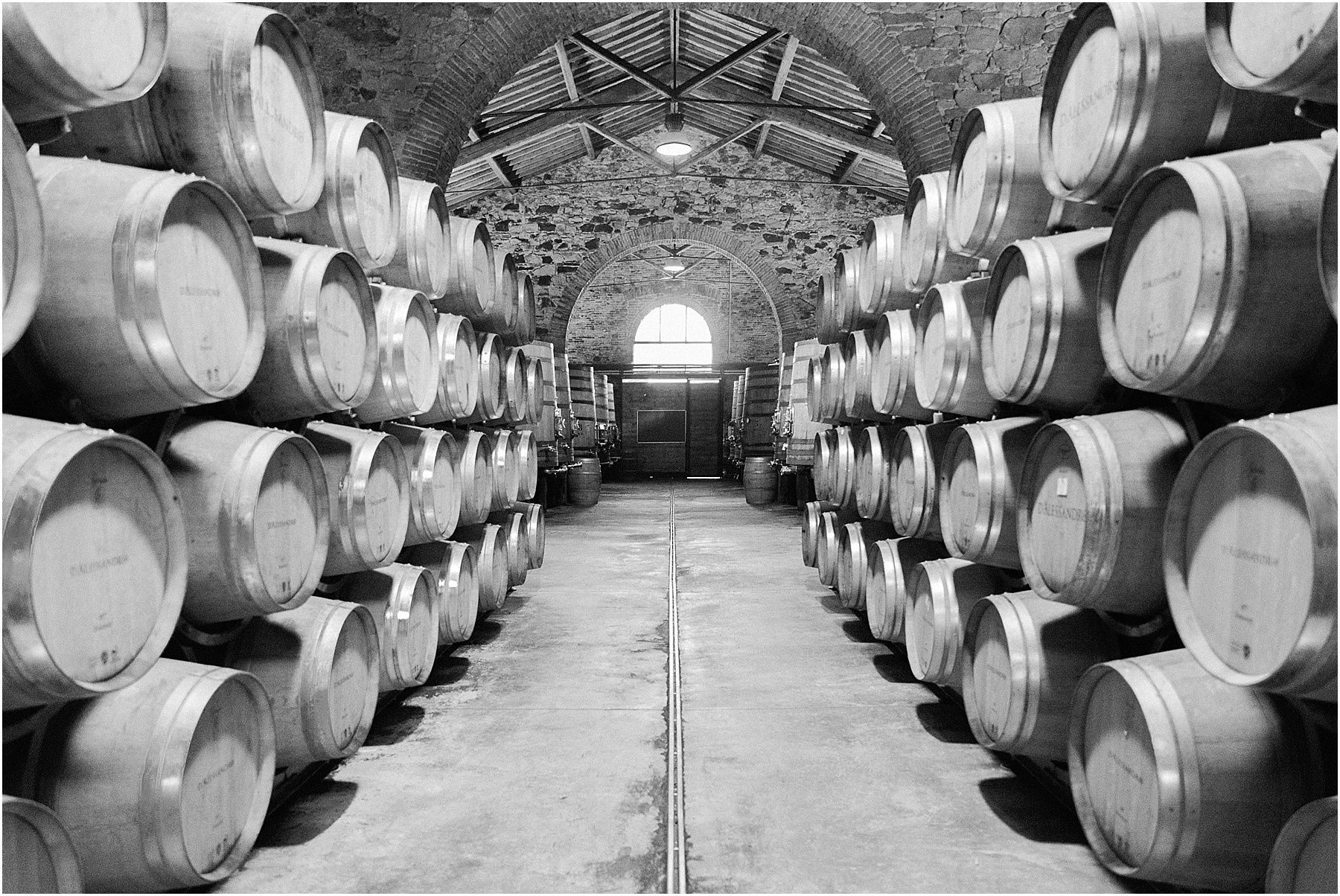 wine cellar black and white at cortona winery vineyard tenimenti d'alessandro osteria borgo syrah