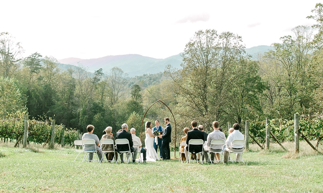 small wedding elopement in asheville nc wedding with mountains in background mountain wedding mountain elopement