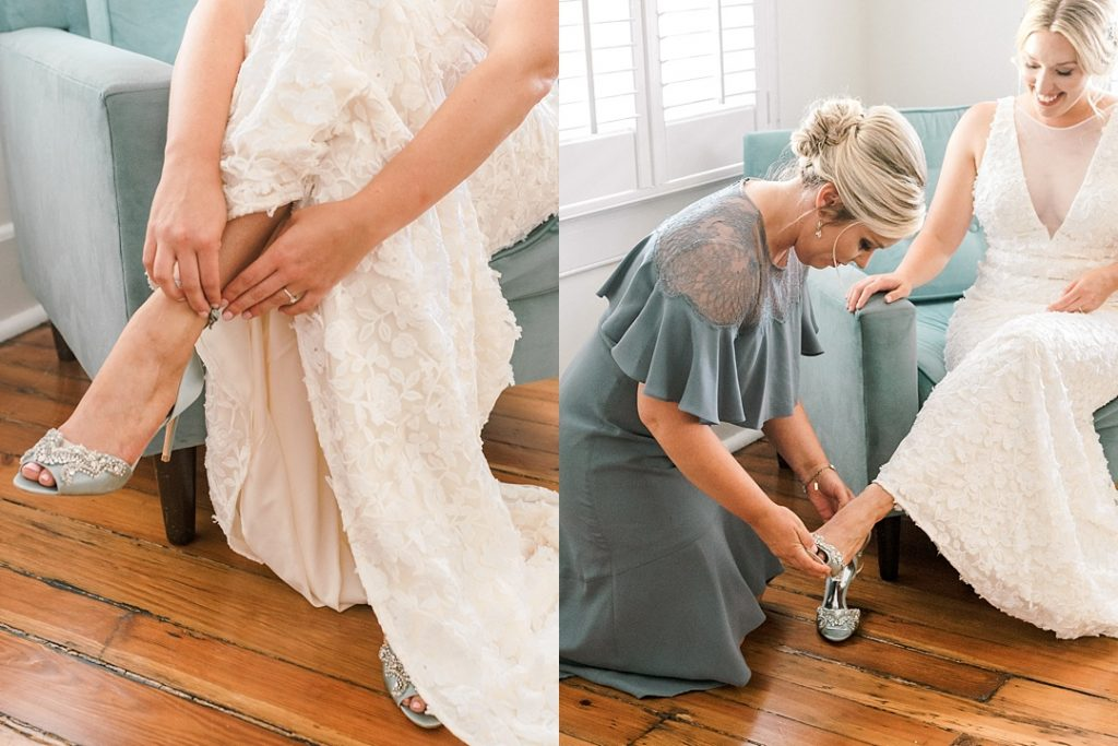 bridesmaid helping bride put on shoes charleston wedding photography