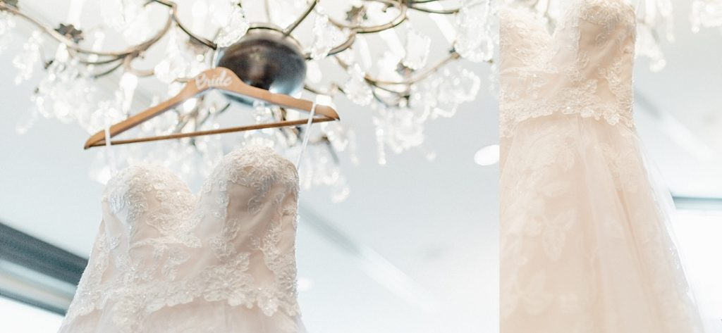 dimitra designs wedding gown hanging from crystal chandelier commerce club greenville sc