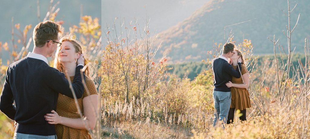 engaged couple kisses and smiles in the fall foliage at black balsam knob