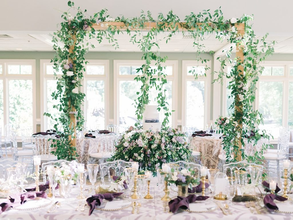 wedding reception at cliffs at glassy purple lavender greenery lush secret garden reception suspended cake gold accents greenville sc wedding