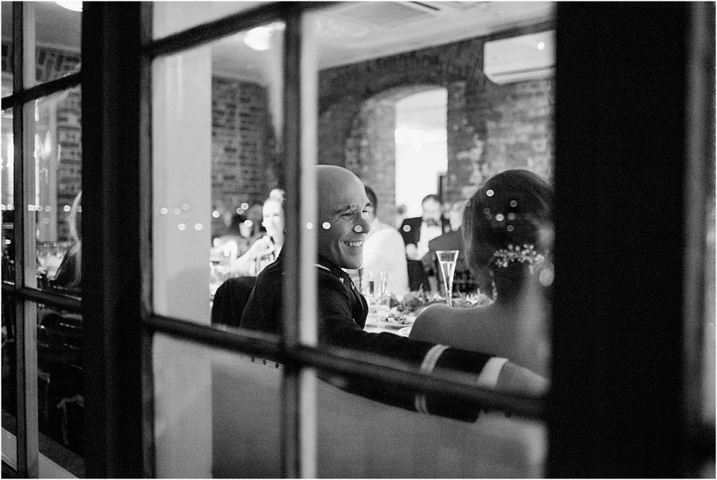 bride and groom through window