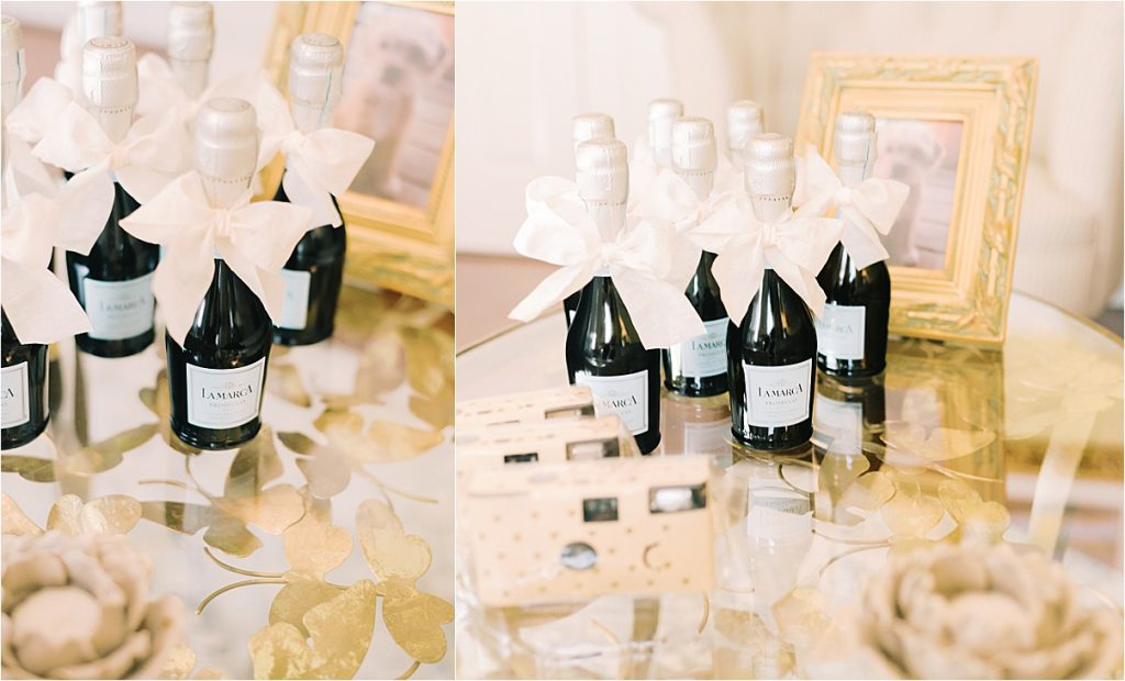 small champagne bottles and bridesmaid gifts on gold table charleston sc wedding details