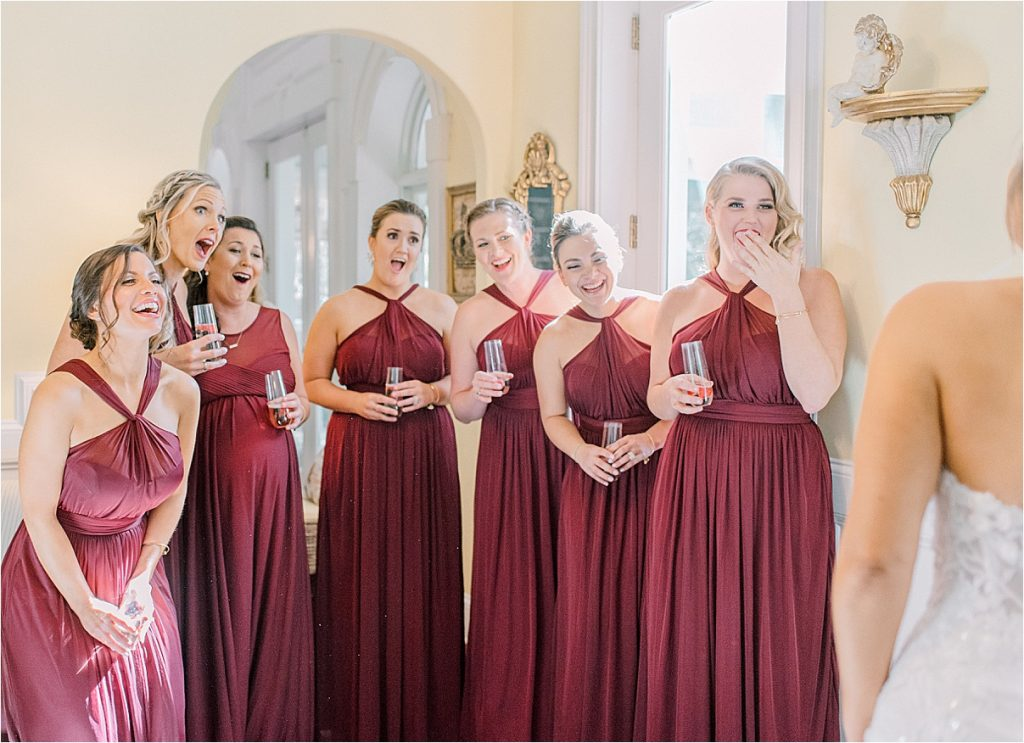bridesmaids react to seeing bride in her dress sc wedding photography