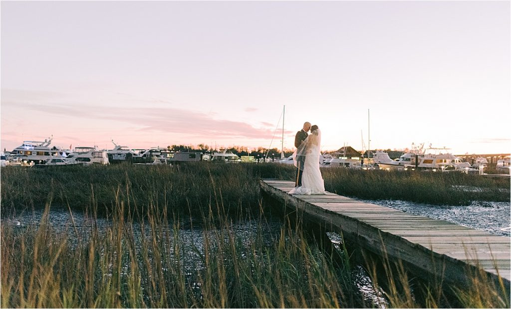 bride and groom portraits at historic rice mill blue hour golden hour portraits charleston sc wedding photography on the marsh charleston marina harbor