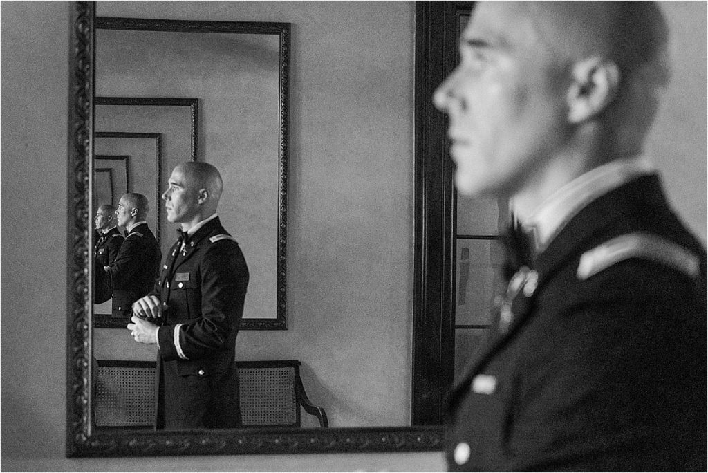 groom before his charleston wedding at the citadel groom in mirror black and white repeating reflections