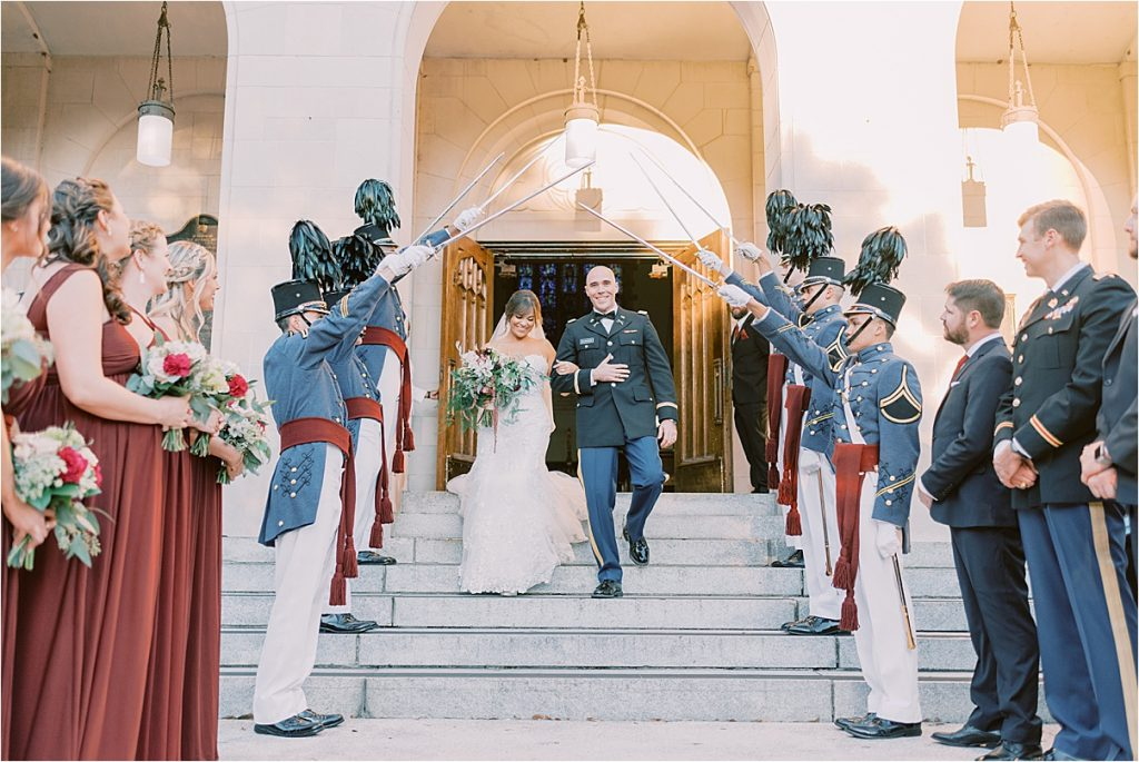 bride and groom leaving their wedding ceremony charleston wedding at the the citadel summerall chapel
