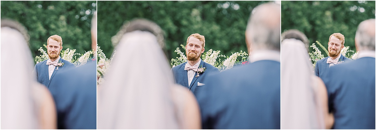 Groom crying and smiling as bride walks down the aisle greenville sc wedding
