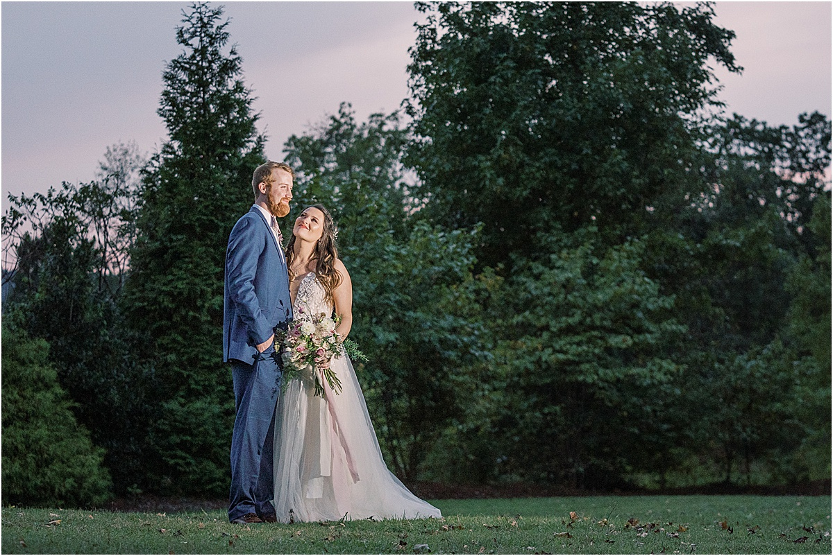 bride and groom with view of mountain tops and colorful sunset in greenville sc wedding viewpoint at buckhorn creek