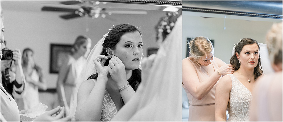bride getting ready with mom putting her jewelry on in the mirror viewpoint at buckhorn creek greenville sc weddings