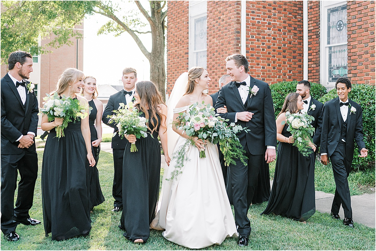 Wedding party walking outside church Greenville SC wedding photography