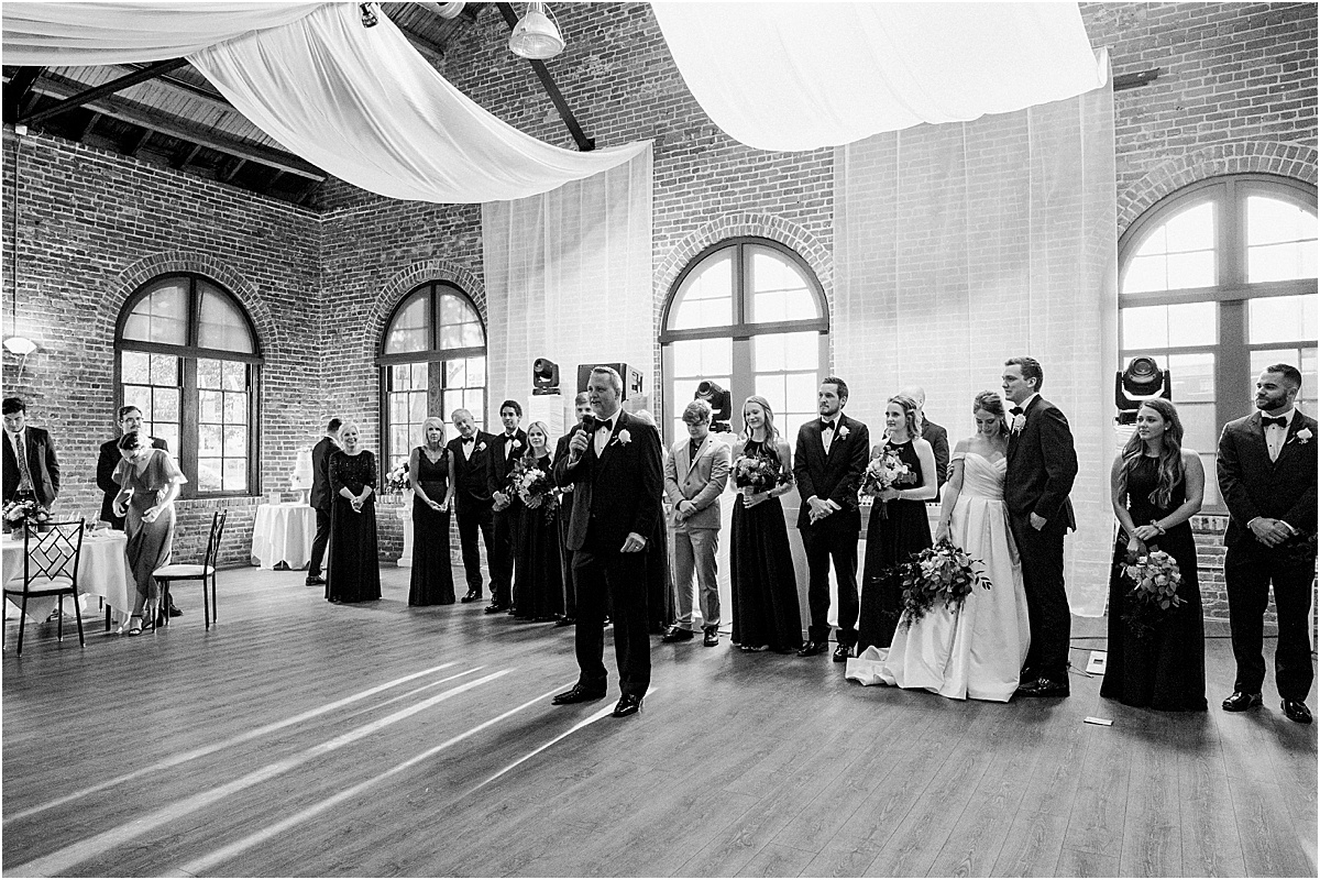 Wedding party and speeches at Larkin's The L event space downtown Greenville wedding